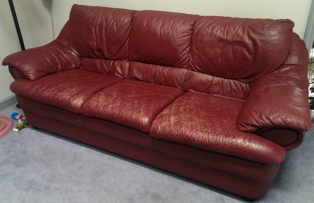 Leather couch with sun damage